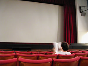 man facing cinema screen